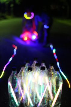 Glow in the dark bowling outside..glow sticks in water bottles...camping just got really exciting
