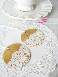 doily gift tags:: love this idea. Can buy packs of doilies at dollar store. Sweet! Make red circles or hearts for Christmas gifts