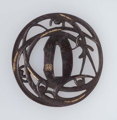 Tsuba with design of orchids and reeds | Museum of Fine Arts, Boston