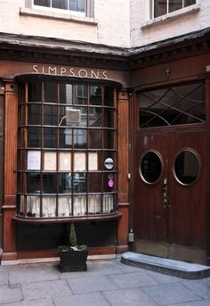 Tucked away in a narrow alleyway, the premises were originally built as two houses in the late 17th century and then converted into a tavern.  Located near the Bank of England and frequented by bankers.  Lovely old pub with food..  Located in the Cornhill area of London, England.