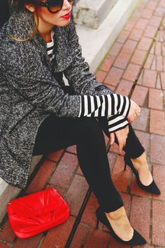 Grey and black wool jacket, black and white striped long sleeve t-shirt, black skinny jeans, black heels, and a red clutch.