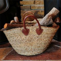 This would make a great summer handbag  http://www.harabuhouse.com/item/JUTE-WOVEN-FIREWOOD-BASKET/134/c55