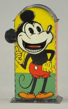 "MIckey Mouse tin mechanical bank (rare), 1930's 7"" Saalheimer & Strauss, Germany, one of four in rare series - this is type 3, depicting Mickey Mouse with pointing finger, pulling down his ear causes tongue to protrude for coin placement and deposit as eyes roll back. provenance: Max Berry Collection via: Bertoia Auctions"