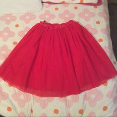 Red tulle skirt Red tulle skirt. Reposh. Five layered and goes above my knee I am five six. Satin waistband. 30' waist. Feel free to make an offer!  Skirts Midi