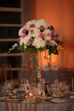 Rustic elegance was the theme for our bride and groom getting married at Stonehouse and these tall pink and white centerpieces were beautiful with hanging crystals.