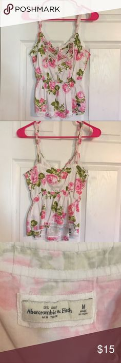 Abercrombie Floral Tank Top White ruffled Tank with pink flowers- cinched at the waist- size M- beautiful and perfect for summer- would keep if it it still fit me 🌸💕🌸 Abercrombie & Fitch Tops Tank Tops