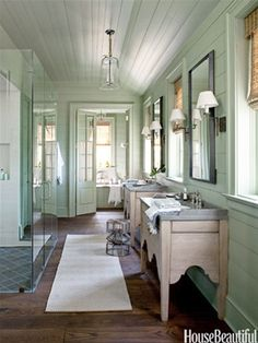 Hidden medicine cabinets recessed behind large mirrors