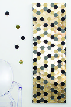 Awesome, simple DIY wall art with punched hexagons!