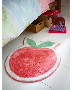 Catherine Lansfield Pony Apple Rug This juicy apple shaped rug with his blue bow tie has been specially designed to sit with the Pony bedding range. Its a soft. fluffy treat for your little ones feet and it can even be machine washed!  http://www.comparestoreprices.co.uk/carpets-and-rugs/catherine-lansfield-pony-apple-rug.asp