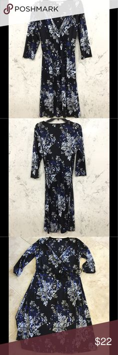 NINE & CO BY NINE WEST JERSEY KNIT DRESS 100% polyester and there is a lot of stretch. There is an elastic gathering at the shoulder and a tie belt in black that is sewn in the side seams. Nine West Dresses Midi