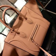 tan Celine phantom bag.