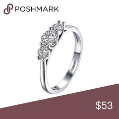 Swarovski Crystal Silvertone Round-Cut Trio Ring Frost your digits with this stunning ring enriched with crystals from Swarovski® for dazzling style.  Face: 1.1'' W x 0.55'' H Band: 0.98'' W Rhodium-plated brass / Swarovski® crystal Swarovski Jewelry Rings