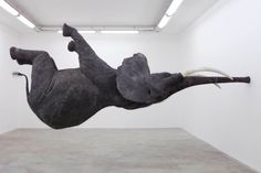 French artist Daniel Firman's elephant balancing on its trunk