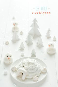 meringue igloo filled with chocolate mousse + snowman meringues...the winter scene with 3D paper trees is divine.