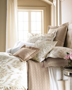 I love this ikat-print bedding for a subtle trendy look — just the right amount of exotic pattern in wonderful, go-with-anything colors.