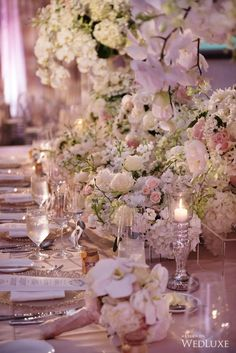 We are so obsessed wit these florals! | WedLuxe – A Storybook Wedding | Photography by: Hong Photography and Cinema Inc. Follow @WedLuxe for more wedding inspiration! #wedluxe #wedluxemagazine #storybook #storybookwedding #whitewedding #weddinginspo #chinesewedding #weddingflowers #weddingflorals #pinkflowers #whiteflowers
