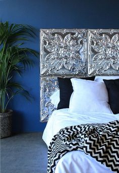Tin ceiling panels make a striking headboard, as seen on Homegirl London.