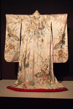 Kimono (furisode) of white satin heavily embroidered with flying cranes and large flowers, Japanese, 20th century, KSUM 1983.1.844.