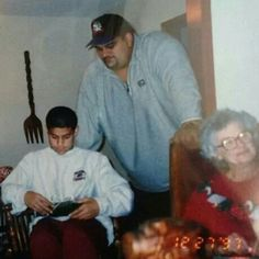 Matthew Anoa'i (Rosey) and his brother Joe Anoa'i (Roman Reigns) with their grandmother