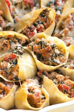 This family-friendly stuffed shells recipe with spinach, sausage, tomato and ricotta cheese will make just about anyone reach in for more. From inspiredtaste.net / @inspiredtaste