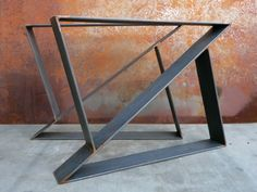 This contemporary table leg design is simple yet very modern. Specifications: Price is for set of 2 Material: -3x1/4 Flat Bar Steel Top Plate: -If you would like for us to weld on brackets to bolt on a table top, you could just leave a note with your purchase saying you would like brackets on the top plates. Finish Options: -Natural/Raw Steel (Rust Prone!!) -Red Primer -Flat Black Once item is purchased, please leave a note as to what finish you would like. If no note is left,...