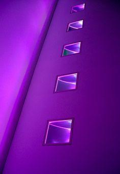 windows in a purple wall