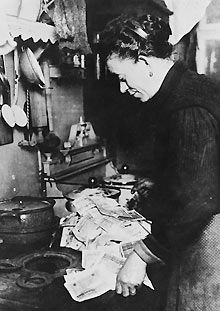 German woman burning money to fuel her stove during the post-World War I hyperinflation in At the time, an American dollar was worth 800 million German marks. Half The Sky, American Dollar, German Women, Science Photos, Women In History, Photo Library, The Good Old Days, Old Pictures, World War Ii