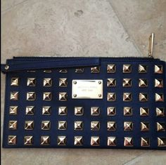 Michael kors pyramid Studded wristlet, wallet Like new condition Color: navy Mk Stud clutch,  best match with michael kors hamilton studded. Light pen mark inside. michael kors Bags Clutches & Wristlets