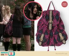 Aria's black studded blazer and pink aztec print backpack on Pretty Little Liars. Outfit Details: http://wornontv.net/16681