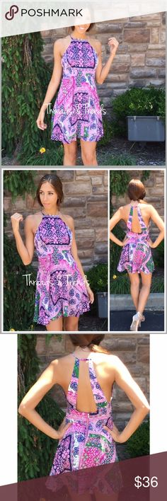 "Open Back Paisley Halter Dress Unique blend of periwinkle, pink, navy and green paisley floral print halter dress. Features button hole closure at neckline and zipper closure at waistline. Made of rayon.                                                                                                                                         Small bust 34"" Waist 32"" Length 35""  Medium bust 36"" Waist 34"" Length 35""  Large bust 38"" Waist 34"" Length 35""  Straps: Front 6"" Back 11"" Threads & Trends…"