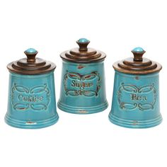 Ceramic, mango wood, and metal canister with embossed detail.      Product: Set of 3 canisters   Construction Material: ...