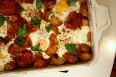 Baked Eggs tomatoes and smoky potatoes
