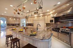 Love the kitchen space minus the hanging pots and pans
