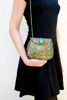 Export quality metal clutch purse with green agate stones. It is a purse for the women who want a different yet precious looking evening purse.It contains a reg