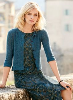 The cropped cardigan is full-fashion knit of feather-weight baby alpaca (60%), nylon (35%) and wool (5%), with a crewneck, ¾-sleeves and ribbed trim.