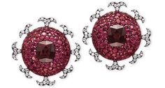 JAR Paris. A PAIR OF GARNET, RUBY AND DIAMOND EAR CLIPS, BY JAR. Each designed as a pavé-set ruby dome, centering upon a cushion-shaped almandine garnet, weighing approximately 7.45 and 7.48 carats, to the diamond-set foliate border, 2001, 3.9 cm, with French assay marks for silver and gold. Signed JAR Paris. Price Realized $417,607 / Estimate $210,000 - $300,000 [C. JEWELS FOR HOPE: THE COLLECTION OF MRS LILY SAFRA - 14 May 2012 - Geneva] #JAR #JARParis #JoelArthurRosenthal
