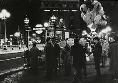 Photograph outside Piccadilly Circus Underground, taken on New Year's Eve, 1962 by Edwin Sampson.