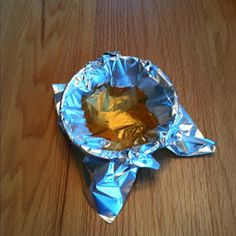 DUH! Put aluminum foil in a bowl, pour the grease in. When it hardens, roll up the foil and throw it out!