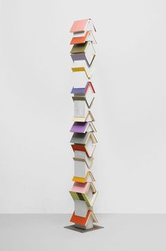 Artists Ronnie Yarisal and Katja Kublitz achieve wonderfully thought-provoking work. This sculpture is beautiful in its strong angles and mixture of colours. Totem poles often reflect extraordinary legends, notable figures, history, story and artistic beauty - the perfect description of what lies between the covers of a book too.