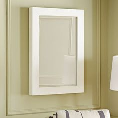 Benjamin Moore 2148-40 Light Khaki, yellow that can turn toward gray -- usually with a green undertone regardless. From West Elm (2012).