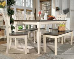 The welcoming cottage design of this rectangular dining table set with a bench includes a two-tone finish over select veneers and hardwood solids. The table top is a burnished brown woodtone finish with a cottage white finish for the aprons and legs of the table. Four slat back, two-tone side chairs and a bench that can seat up to two provide seating for friends and family at this table. This table is perfect for a kitchen dining area or semi-formal dining space.