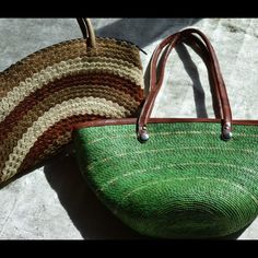 Get ready for good weather! Two great straw bags ! Brown appears to be handmade , green is not handmade. Brown and cream bag 13.5 wide 8.5 deep. Green 14 wide 9 deep both zipper closure. Straps in excellent condition no major signs of wear! Bags