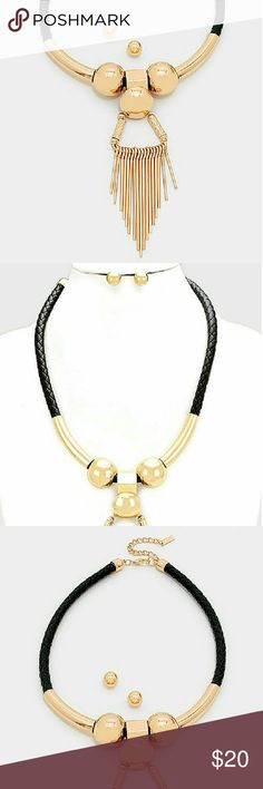 """Gold with Faux Leather (Tube Fringe) Necklace Set Elevate your style with this dramatic statement necklace. Gold goodness with fringe and vegan leather make it the perfect piece to top off any glamorous ensemble.  Product Info:  * NECKLACE SIZE : 19"""" x 3"""" L * DECOR SIZE : 5.50"""" L * EARRINGS SIZE : 0.4"""" L * LEAD & NICKEL COMPLIANT * COLORS/DETAILS: Black & Gold Filled Fring Necklace *  IMPORTED Celina Nicole Luxe Fashion Jewelry  Jewelry Necklaces"""