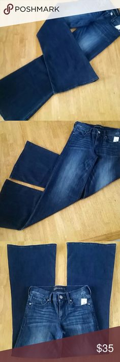 """EXPRESS RETRO BELLS Mod Squad Retro!!!  Super Wide Leg Flare Style By EXPRESS Jeans. Mid Rise. 75 % Cotton 24 % Poly 1%.. Rise 9"""" Inseam 33 1/2  New with tag  Never worn Express Jeans"""