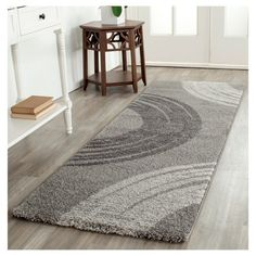 Add an extra touch of depth and character to your room's décor with a Safavieh, Bedford Rug. This charming accent rug boasts a contemporary color palette and a simple, yet striking circular design. Perfect for hard surface floors and high-traffic areas throughout your home. The low-pile construction is soft, durable and effective at trapping dirt. Available in a variety of sizes to expertly fit your floor plan.