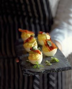 from Contributing Chef Melissa Perello. Smoked deviled eggs from Park Tavern.bacon pickled jalapeno chives spicy appetizer