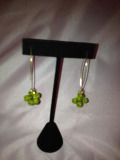 Golden loop earrings with green by SassyGirlJewelrycom on Etsy, $35.00