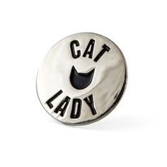 "Cat lady pin - Silver pin with black enamel - Rubber backing - Measures .875"" wide"