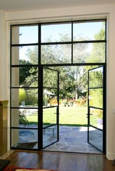 Steel doors - modern but have a rustic feel Steel Windows, Steel Doors, Windows And Doors, Beach House Kitchens, Rustic Feel, Industrial Style, Interior And Exterior, Townhouse, My House