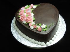 Floral Heart Cake - Rich chocolate ganache covered heart cake with a pink floral spray Pretty Cakes, Beautiful Cakes, Amazing Cakes, Heart Shaped Cakes, Heart Cakes, Flourless Chocolate Cakes, Chocolate Ganache, Chocolate Covered, Tortas Light